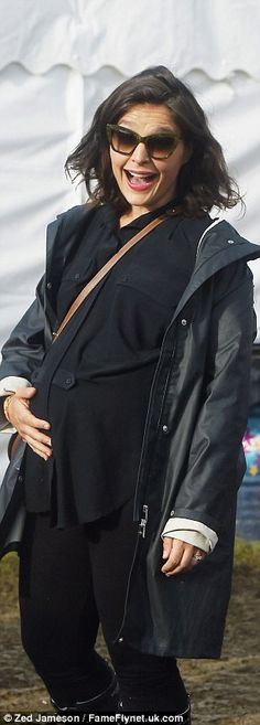 Yummy mum: Pregnant Jessie Ware donned all-black for the muddy festival