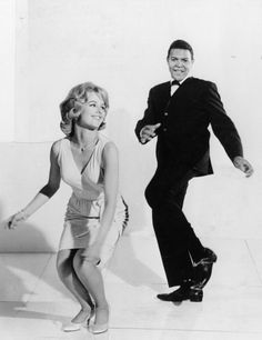 """The Twist: Popular American singer Chubby Checker, who had an enormous hit with """"The Twist"""" in 1960, which spawned the dance craze of the same name, tries twisting with a friend. (circa 1961)"""