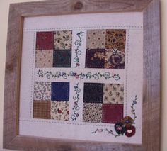 Here's another framed block to go with the Grandmother's flower garden block... I like the combination of quilting and embroidery.