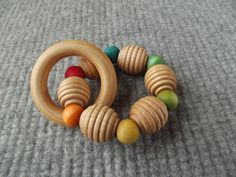 Hey, I found this really awesome Etsy listing at https://www.etsy.com/listing/180119619/wooden-rainbow-beads-rattle-organic-baby