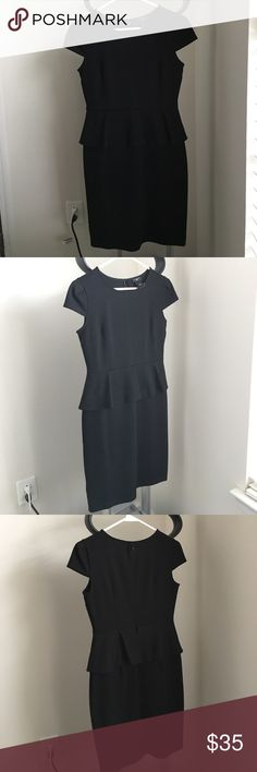 NWT Ann Taylor Peplum Dress NWT black AT short sleeved peplum dress. 73% polyester 23% rayon 4% spandex Ann Taylor Dresses