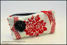 Red and white petite zipper bag with black & white polka dot interior