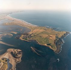 This is Holy Island in Northumberland England. It is on the northeastern point, just below Scotland, Holy Island is only accessible twice daily when the tide goes out. The building on the hill on the southeast side is Lindisfarne Castle St Aidans, Berwick Upon Tweed, Ireland Holiday, Northumberland England, Great North, North East England, Uk Holidays, Pilgrimage, Aerial View