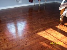 After photo of G.P.J. bedroom floor. Stained one coat then hand painted design with the same stain, then placed random drips-drops of stain on floor, misted over design with diluted stain & thinner then sealed with clear poly.