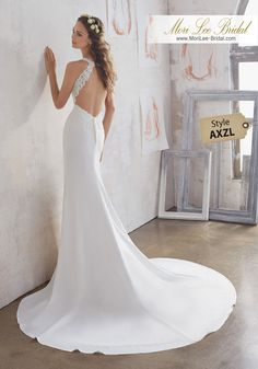 Style AXZL Marquita Wedding Dress  A Fresh Take on a Classic Crepe Sheath Wedding Dress. Crystal Beaded Alençon Lace AppliquŽés Accent the Bodice and Open Keyhole Back. Colors Available: White, Ivory. Shown in Ivory.