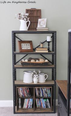 I like the framed keys; Farmhouse Style Storage for DVD's & Xbox Games