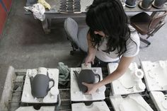 Heath Ceramics, removing cast forms from mold.