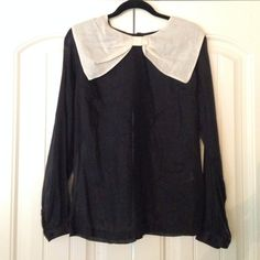 Topshop Bow Top, sz 6 Cotton/ silk blend top by Topshop. Uk sz 10, Euro 38, US 6. Sheer black with off white bow at neck. Black covered buttons all the way up the center back. Never worn. Topshop Tops