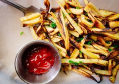 Oven-baked herb parsnip fries are crisp outside, tender inside -- seasoned with fresh chives and parsley.