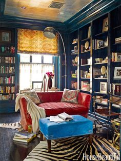 Check out 20 home libraries that will give you shelf envy, including this cozy corner.