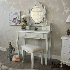 Grey Dressing Table, Mirror and Stool - Claudette Range A beautiful dressing table, large swing mirror and stool set Perfect for a girly bedroom with more items available in this range, the mirror has 2 small trinket drawers and 2 drawers on the dressing table and soft padded stool With a white floral motif on the top of the mirror and stool and rounded oval drawer handles In a subtle grey colour with a hint of a mushroom colour that closely matches Shadow White from the Farrow & Ball…