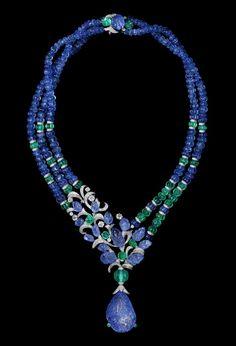 L'Odyssée de Cartier Parcours d'un Style 'India' Necklace in platinum, set with a 67.94ct carved sapphire, melon-cut sapphires, emeralds, and diamonds.