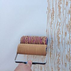 Try something that looks like wallpaper but is way easier. Modern rollers in patterns that range from feminine florals to faux bois. They'll transform your walls instantly!