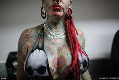 Impressive and scary tattoos and body art from the 4-day convention in Venezuela.