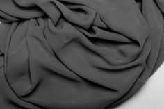 black and white background texture satin fabric with folds
