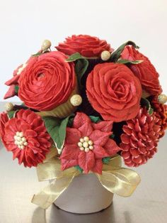 Christmas cupcake bouquet. A festive bouquet is the perfect centrepiece for any occasion. By Marisskiss Cakes Co.