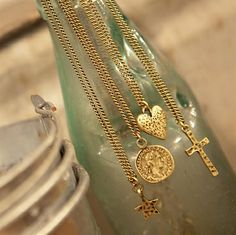 Tutti & Co short necklaces with charms.  Heart pendant on necklace in antique gold available to purchase at LBD Boutique - £12  LBD Boutique Ships Internationally  http://thelittleblackdressboutique.co.uk/products/227910--tutti-co-heart-on-gold-necklace-nn58g.aspx