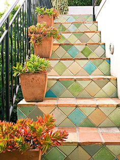 Stepping in Style Colorful tiles affixed to these stair risers give the outdoor staircase personality and style. The pastel color palette enlivens the home's neutral exterior without looking too bold.