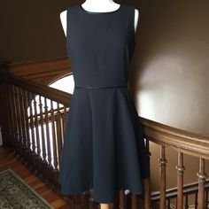 "Loft black dress Lift black dress, sleeveless, leather trim around neck, pocket and waist. Exposed zipper up the back, pockets at the hips.  Petite size, waist to hem 18 1/2"".  63% polyester, 31% rayon, 6% spandex. Never been worn. Perfect condition. Loft Dresses"