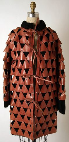 Coat, Paco Rabanne, French coat made in the 1960s. Known for offbeat materials, assymetrical cuts. This coat is  exemplary of Rabanne's style.