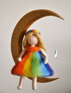 Children Mobile Waldorf inspired needle felted : The Rainbow fairy in the moon with crystal. MagicWool via Etsy.