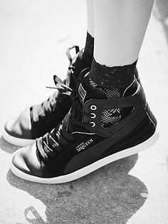 Alexander Mcqueen Terena High Top | These McQueen high tops are an elevated classic, featuring a polished mix of suede, leather, and brass, with a rubber sole. Chic side cutouts.  *By Alexander McQueen for Puma