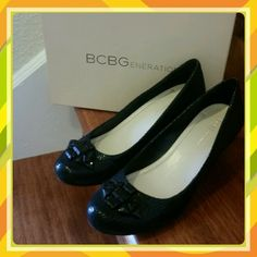 BCBG Generation Treese Wedge Pump BCBG Generation Treese Wedge Pump in black snakeskin suede, with a pretty front ornament that adds elegance to these cute and comfortable slip on wedges.  Used 1x, in great condition.  Great for dress up or with your favorite jeans. BCBG Shoes Wedges