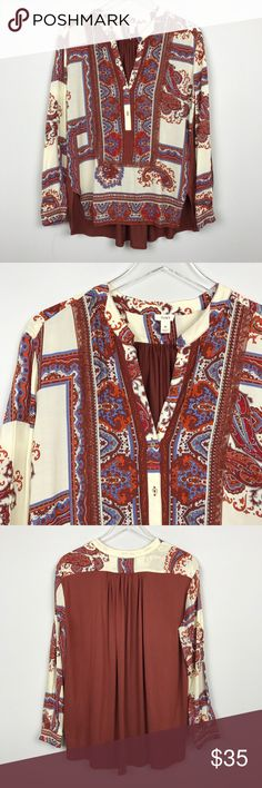 """[Anthropologie] TINY Nahara Paisley Tunic Top Boho Long sleeve Paisley print pullover top. Henley button placket. Button cuffs. Contrast knit back panel. High low hem. Loose fit. By TINY from Anthropologie.  🔹Pit to Pit: 19"""" 🔹Length: 26"""" - 28"""" 🔹Condition: Excellent pre-owned condition.  *AA12 Anthropologie Tops Blouses"""