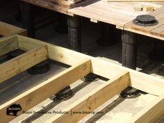Bison Adjustable Deck supports using both wood tiles and traditional joist decking