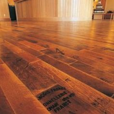 eclectic wood flooring by Fontenay - wine barrels