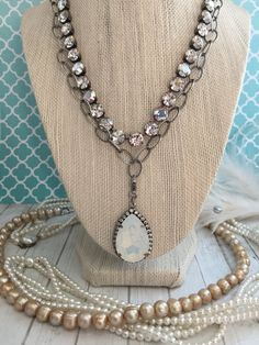 Items similar to Large Detachable Swarovski Pear Pendant with halo accent. Set in Antique Silver. Alternate color options available. White Opal, Chrysolite on Etsy Vintage Jewelry Crafts, Antique Jewelry, Handmade Jewelry, Pink Opal, White Opal, Bohemian Necklace, Bohemian Jewelry, Swarovski Pendant, Swarovski Crystals