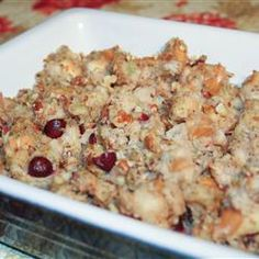 "Cranberry Nut Stuffing | ""Made this in the crockpot and stuffed the bird with it for Thanksgiving this year. There wasn't a single drop left over. Note: I used fresh cranberries halved and all of the nuts that were called for as well as the full can of broth in the crock pot."""