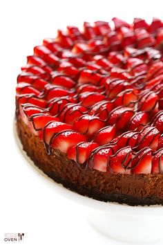 Strawberry Nutella Cheesecake from one of my favorite blogs! She says: This strawberry Nutella cheesecake recipe is made with a classic Oreo crust, a somewhat lighter Greek yogurt filling, and topped with strawberries and Nutella galore!