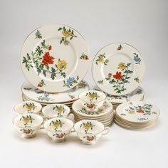"""Castleton """"Ma Lin"""" China features the Ma Lin pattern of red, yellow, and blue flowers on an ivory background, with gold toned rims - """"Castleton China/Ma Lin by Ching-Chih Yee/Made in USA""""."""