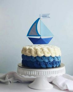 A paper sailboat cake for baby Tristan's month celebration! Customer requested that I replicate a design from a photo she found off the internet. The topper involved abit of art and craft and that is definitely one of my fav things to do! Baby Shower Cakes, Baby Boy Shower, Sailboat Cake, Giant Cupcakes, Rodjendanske Torte, Cakes For Boys, Themed Cakes, Cake Designs, Cake Toppers