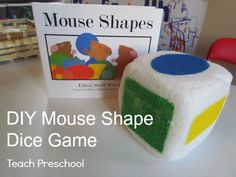 "Follow up a reading of ""Mouse Shapes"" with a dice game. (one side of the dice has a painted mouse) Many possible ways to play with this dice..."