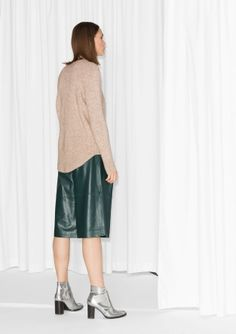 A sophisticated, knitted sweater made from a warm wool and alpaca blend.