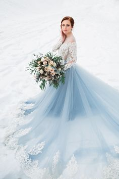 - Long sleeve A line gown - Off the shoulder illusion neckline - Sheer beaded lace bodice - Chapel train - Closure: buttons and zipper Blue Wedding Gowns, Wedding Dress Train, Wedding Dress Trends, Colored Wedding Dresses, Bridal Dresses, Wedding Colors, Wedding Ideas, Blue Weddings, Gown Wedding