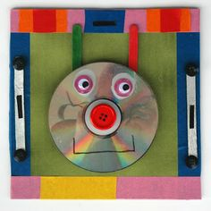 CD face. Recycled CD, tape, glue, googly eyes, Popsicle sticks, markers, buttons. This one was made by a 2nd grader student.