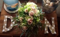 This is the wedding bouquet my wife Sara  made for our daughter, Natalie , with hydrangeas grown at our farm, ... blush roses, succulents, eucalyptus & another wispy greenery & She loved it! Sara's in the process of preserving it for her.