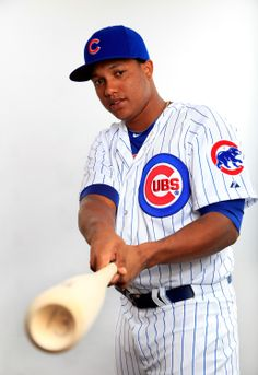 TEMPE, AZ - FEBRUARY 24: Starlin Castro #13 poses during Chicago Cubs photo day on February 24, 2014 in Tempe, Arizona. (Photo by Jamie Squire/Getty Images)