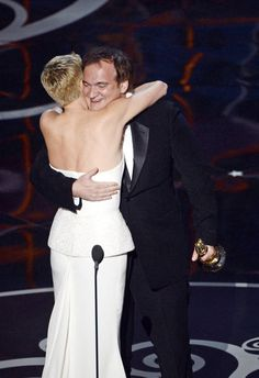 Charlize Theron hugged Quentin Tarantino at the 2013 Oscars