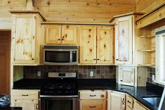 pine cabinets, black counter - i like the contrast on the backsplash: very… Kitchen Cabinets On A Budget, Espresso Kitchen Cabinets, Wooden Kitchen Cabinets, Kitchen Cabinet Design, Kitchen Redo, Rustic Kitchen, Country Kitchen, New Kitchen, Kitchen Remodel