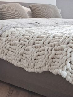 $470,00E Double bed blanket, natural white yarn w/ taupe ribbon (blanket stitch detail along hem) Basket stitch blanket Taupe-Double | Knittingnoodles *I love this ticking linen shams + bed sheets on this bed.  I could make this blanket in about a week b/c it's HUGE needles - like 13 or 15 size needles + super bulky yarn - which they sell as well.  You could also buy this white-ish yarn and dye it to match.  Cute throw as well.