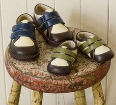 See Kai Run soft-soled shoes for babies and tots. They are adorable, colorful, and easy to put on wiggly feet!