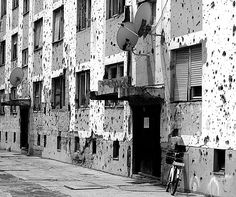 Vukovar (Croatia) - Roots of the War - panel house with holes after being under heavy fire