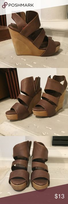 Faryl Robin Brown Leather Wedges Faryl Robin brown faux leather wooden platform wedge heels. Inside has some peeling but can't be seen when worn. Size 6. Great used condition. Faryl Robin Shoes Wedges