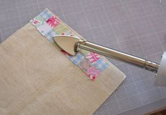 This pinner is making a tiny scrap quilt & uses a Clover Mini Iron to iron the tiny squares.  Think I need to find one of these & put it on my Christmas list!