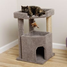 Give Fluffy a stylish and cozy home with this adorable corner cat condo with three floors: a hidden hideaway, a play area with textured tubes ideal for restless claws and a playful sisal rope toy, and a penthouse view from the top.