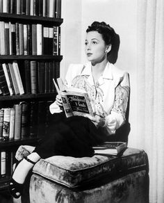 "Olivia de Havilland reads Thomas Mann ""The Transposed Heads."" The novella, ""The Transposed Heads"" is Thomas Mann's philosophical version of an Indian legend about the conflict between mind and body. In a twinned paroxysm, two friends, the intellectual Shridaman and the earthy Nanda, behead themselves."